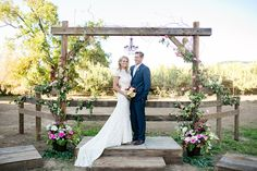 Gorgeous rustic barn wood wedding arbor complete with wild apples, roses and a chandelier | Tin Roof Barn