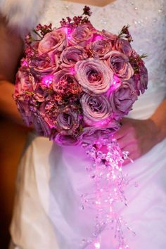 Disney theme wedding fairy tale wedding - purple glowing bouquet with crystal Wedding flowers and planning by Fascinare