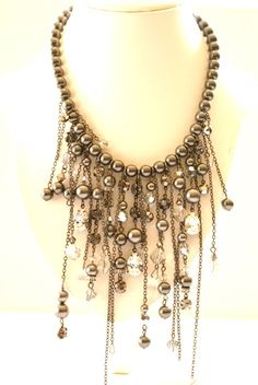 Swarovski crystals and pearls with gunmetal chain by MOSQUITA