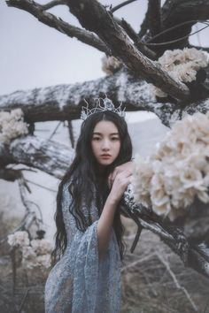 This girl reminds me of Ophelia before she went insane. This picture captures a simple and innocent girl like Ophelia.