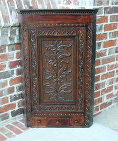 antique freestanding corner cabinet, highly carved