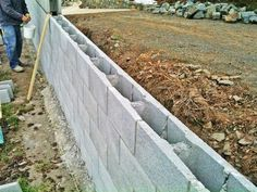 Different Types of Retaining Wall Materials & Designs With Images - Reinforced block retaining wall - Types Of Retaining Wall, Retaining Wall Fence, Concrete Block Retaining Wall, Concrete Fence Posts, Retaining Wall Design, Building A Retaining Wall, Concrete Block Walls, Cinder Block Walls, Landscaping Retaining Walls