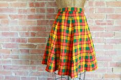Vintage hand made wool skirt. Bright orange, goldenrod, black and pistachio plaid. Zip and button closure. Unlined. > Label: N/A  > Size: Fits like