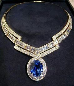 A gargantuan Sapphire with a spectacular 18k white gold baguette set top quality Diamonds set into this staggeringly impressive neck adornment accessory that is not so much a considered purchase, more a second mortgage required to procure it !!