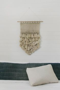 """*Available for Pre-Order. Delivery mid October. Add a touch of vintage style to your decor with The Dharma Door's Jute Macrame Wall Hanging with oversized tassels. Dimensions: 25-1/2"""" high x 17-3/4"""" w"""