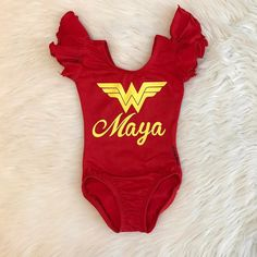 """Instagram @dailythreads_ Featuring our """"Wonder Woman Custom Name"""" Red Flutter sleeve Leotard with plain yellow (non glitter) design! Message me on Etsy to request your custom order today! **Follow/Like my Facebook page @ DailyThreadsByDina and message me for 10% OFF your 1st order!! TheDailyThreads.etsy.com #wonderwoman #superhero #hero #marvel #marvelsuperhero #leotard"""