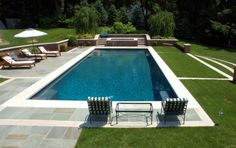 Rectangular pool with grass and stone terraces  love the landscaping favorite*****