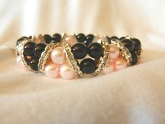 Hey, I found this really awesome Etsy listing at https://www.etsy.com/listing/217062161/pink-black-oldies-style-beads-stretch