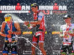 From left, Maurice Clavel of France, silver medal, Jan Frodeno of Germany, gold medal and Frederik Van Lierde of Belgium spray each other during the podium ceremony of the Ironman 70.3 in Barcelona, Spain.   David Ramos, Getty Images for Ironman