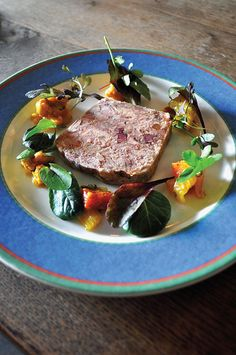 At his 17th century, ivy-blanketed Sandpiper Inn in Leburn, North Yorkshire, Jonathon Harrison hews to country fare like this ham hock and rabbit terrine with piccalilli and mixed leaves.
