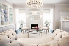 Traditional Living Room with Overstuffed tufted chair, Kate somerville, Spa reception area, Crown molding, Chandelier Spa Interior, Interior Design, Spa Design, House Design, Spa Reception Area, Reception Rooms, Home Epiphany, Spa Lounge, Spa Room Decor