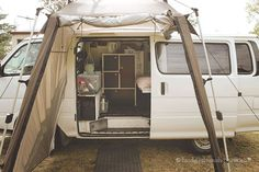 Toyota Hiace campervan all kitted out with a permanent bed and living space.