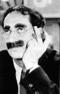 """""""Outside of a dog, a book is man's best friend. Inside of a dog it's too dark to read."""" ~Groucho Marx"""