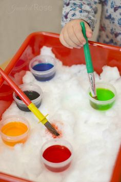 Fill a bin with snow and bring it indoors.  Add colored water and paint brushes for a super fun art activity- what a great idea!  {Lots of other ways to play with snow indoors here, too}