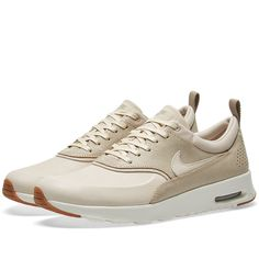 A modern icon, Nike's Air Max Thea lends understated style and ultralight cushioning for everyday wear. Updated with a spring ready oatmeal tone, the combination of leather, textile and synthetic fabric uppers add support onto the lightweight feel. Set on a visible Max Air unit and a durable Phylon midsole for lightweight cushioning.    Leather, Synthetic & Textile Uppers  Visible Max Air Unit  Lightweight Cushioning  Waffle Outsole Pattern  Style Code: 616723-102