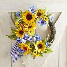 Faux sunflowers are the star in our asymmetric wreath design, and what better bloom to brighten up home and hearth. Its vivid yellow pops among abundant greenery, and every handcrafted detail looks amazingly realistic. It's an instant mood-lifter indoors and is also suitable for display in a covered outdoor space.