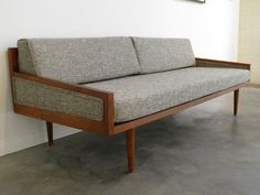 This isn't vintage, but it sure looks it. MID Century MODERN DAYBED Style Sofa with Arms by GoModRetro, $1150.00