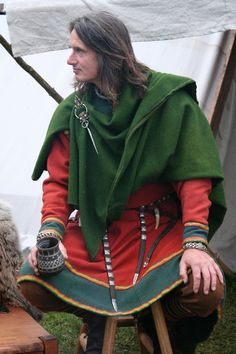 Gorgeous male outfit with wide contrast band on wristbands and hem - (its Alban Depper of http://www.northan.net/) He makes fantastic Norse Jewelry.