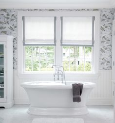 Soothing and lovely grey and white master bath by Muse interiors. Love the roman shades with simple grey ribbon trim, the beadboard, and the floral wallpaper adds interest without being too busy.