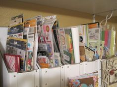 paper holders used to organize scrapbooking stickers   It would be easy to make chip board containers too!