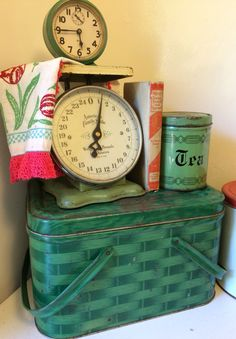 Vintage green: so many lovely old items. Scale, clock, tin picnic basket, embroidered tulip on vintage dishtowel, 1930s cookbook, Grandma's tin canister!