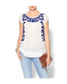 Pair this embroidered peasant top with a pair of cutoffs for a easy summer look. #divinecaroline #summerstyle