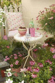 Small table and chair set among the flowers.