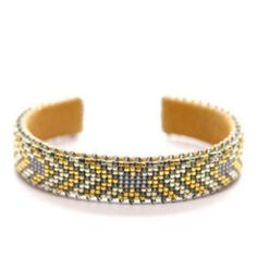 Hand beaded cuff over an adjustable copper band. It is hand-beaded on a traditional Navajo loom and made with high quality seed beads. After the pattern is arranged on the loom, the beads are sewn ont