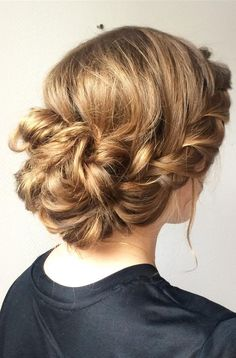 Beautiful messy low updo with a braid hairstyle idea #hairstyle #weddinghair #hairideas #braidhairstyle