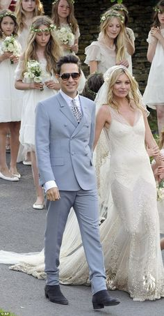 Jamie Hince and Kate Moss, in YSL and John Galliano respectively, with bridesmaids in background