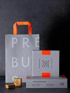鉄のグレーと、鉄を燃やしたときの色を連想させるオレンジを使ったパッケージが目をひく。
