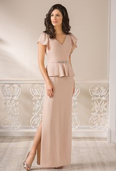 Jade by Jasmine. Peplum sheath with flowing cap sleeves and V-neckline.