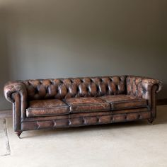 """With a new dark brown color in aged leather that just gets better with time, this Derbyshire sofa is more refined with a 3 cushion seat, rolled arms and tufted details. Also comes in matching Derbyshire chair. 47.5"""" x 18.5"""" x 89"""" Top grain leather with wood frame Wipe leather with a clean microfiber cloth using cleaner Leather Chesterfield Chair, Settee Sofa, Farmhouse Style Furniture, Farmhouse Style Decorating, Distressed Leather Sofa, Painted Fox Home, Striped Cushions, Antique Farmhouse, Modern Farmhouse"""