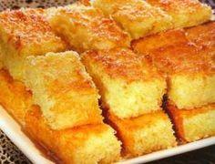 bolo-de-mandioca-de-liquidificador:Modo de Preparo:Comece descascando o aipim e depois corte-o em pedaços;O aipim deverá ser batido no liquidificador com leite;Adicione o açúcar, a margarina e os ovos e bata novamente;Adicione então o coco ralado e bata novamente;Colocar numa assadeira previamente untada com manteiga; 6Deixe assando por cerca de 20 a 30 minutos. 1 kg de mandioca;3 colheres de sopa de margarina;250 ml de leite;100 gramas de coco ralado ou em pedaços;300 gramas de açúcar;4…