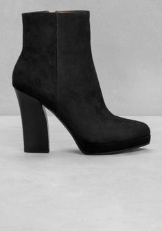 Sophisticated ankle boots featuring an intriguingly sculpted heel made from stacked leather.