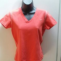 Nike Top Very nice condition. Nice white top-stitching around sleeves, across shoulders and down sides. Nike Tops Tees - Short Sleeve