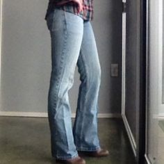 """Levi's superlow Sz 27 jeans Classic Levi's low riding jeans, boot cut 518's. Size has rubbed off the back but equivalent to 27s. Some slight wear to back bottom hems, but no separation of hem.                            Waist. 16"""". Inseam. About 31"""" Levi's Pants Boot Cut & Flare"""