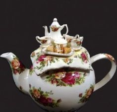Royal Albert China - Collector Teapots- Royal Albert Roses with miniature tea set on lid