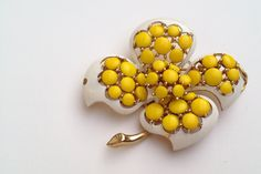 Vintage white and yellow flower brooch pin signed Trifari (c) via Etsy.