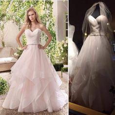 Classy styled blush wedding dress