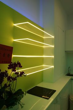 glass shelf lighting floating glass shelves with led light strips create a stunning light source perfect for a contemporary kitchen photo source aurora lighting glass cabinet lamp Accent Lighting, Strip Lighting, Club Lighting, Interior Lighting, Home Lighting, Lighting Ideas, Led Shelf Lighting, Modern Lighting Design, Deco Led