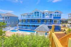 DUNE MY THING, #140 (New Construction for 2015) l Corolla, NC - Outer Banks Vacation Rental Home l Oceanfront home featuring 10 bedrooms (9 masters), elevator, theater room, recreation room, private pool with option to heat, baby pool, cabana bar, hot tub, private beach walkway and dune-top deck. l www.CarolinaDesigns.com
