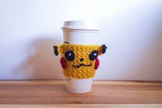 """Family Craft Studio """"Crochet Pikachu Coffee Cozy Pattern"""" -- a free crochet pattern for a Pokemon Pikachu coffee cozy. It includes a pattern for the cozy, ears, eyes, cheeks, stripes, and lightning shaped tail. Lots of pictures to help out along the way."""