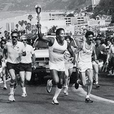 O.J. Simpson with Olympic torch (1984)