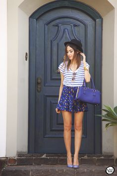I love to mix different prints,dots and Stripes is a classic mix that works so well! Wearing navy blue top and shorts from Shoulder.