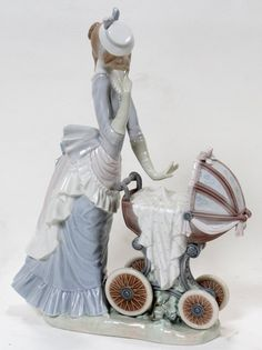 """'BABY'S OUTING', H 14"""":Depicting a woman taking a child on an outing in a baby carriage. Figure #4938 was sculpted by Salvador Debón, issue in 1976 and retired in 2001.   sold for $225"""