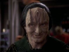 Garak, a Cardassian friend of Dr. Bashir's from DS9. Was he or wasn't he a spy planted there. We still don't know. He was a tailor of all things in one of the Promenade shops.His father was a very high official in the Cardassian government's Obsidion Order.