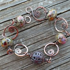 Mosaic - Lampwork, Enameled Filigree and Copper Bracelet. $68.00, via Etsy.