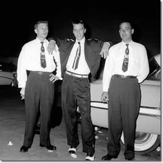 Scotty Moore, Elvis Presley and Bill Black (the first band members to work with Elvis).