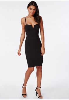Look seriously seductive in this chic black midi dress. With structured  slight V neck,
